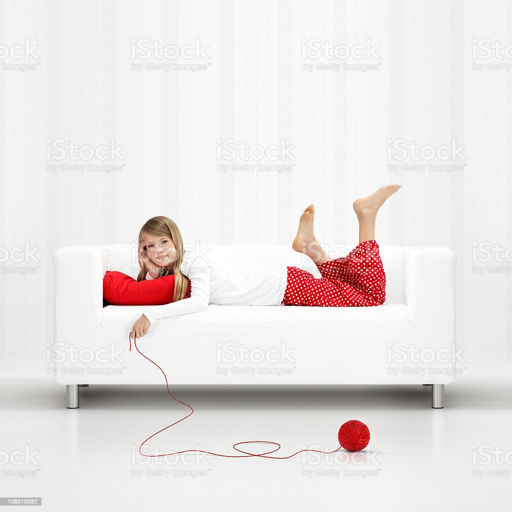 Girl with ball of red wool royalty-free stock photo