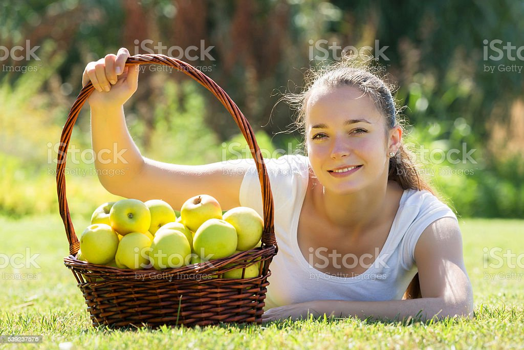 Girl with basket of apples royalty-free stock photo