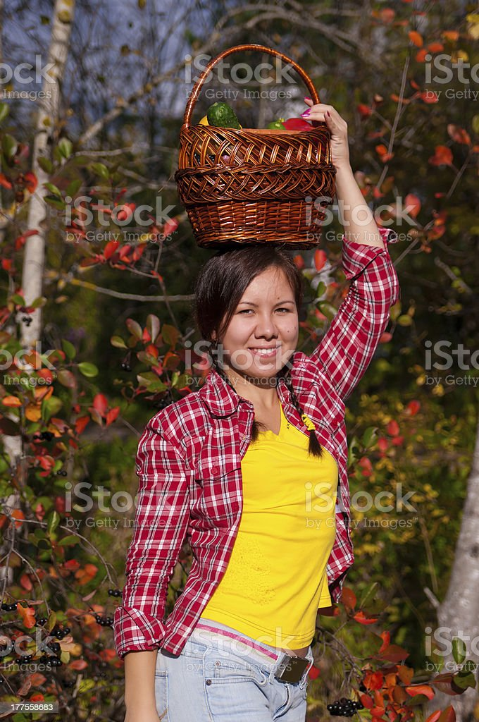 Girl with basket of vegetables royalty-free stock photo