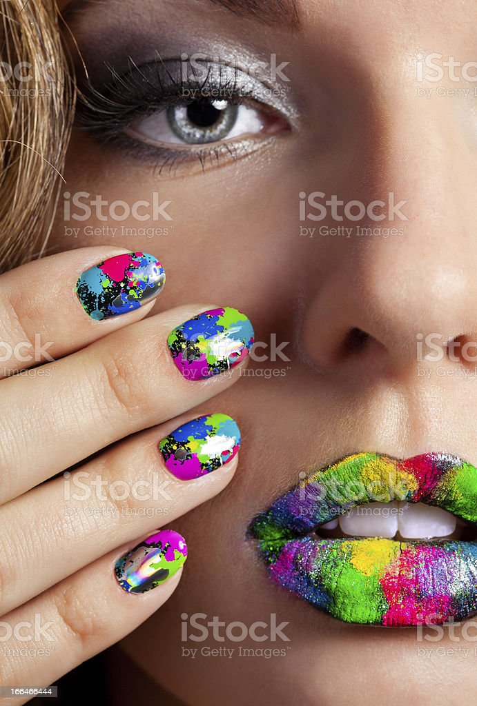 Girl with beautiful multicolor Minx nails and make-up stock photo