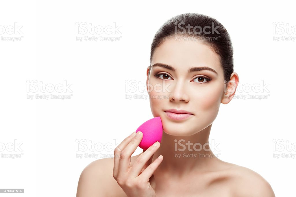 Girl with beauty blender sponge stock photo