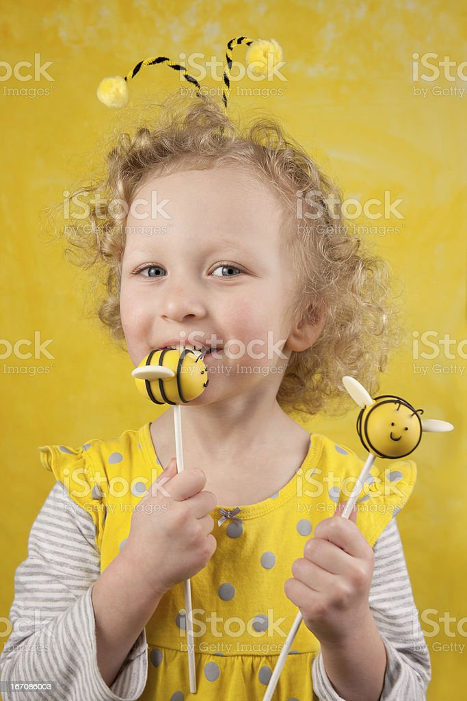 Girl with bee cake pops stock photo