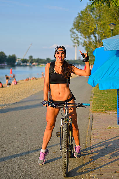 girl with bike - belgrade serbia stock photos and pictures