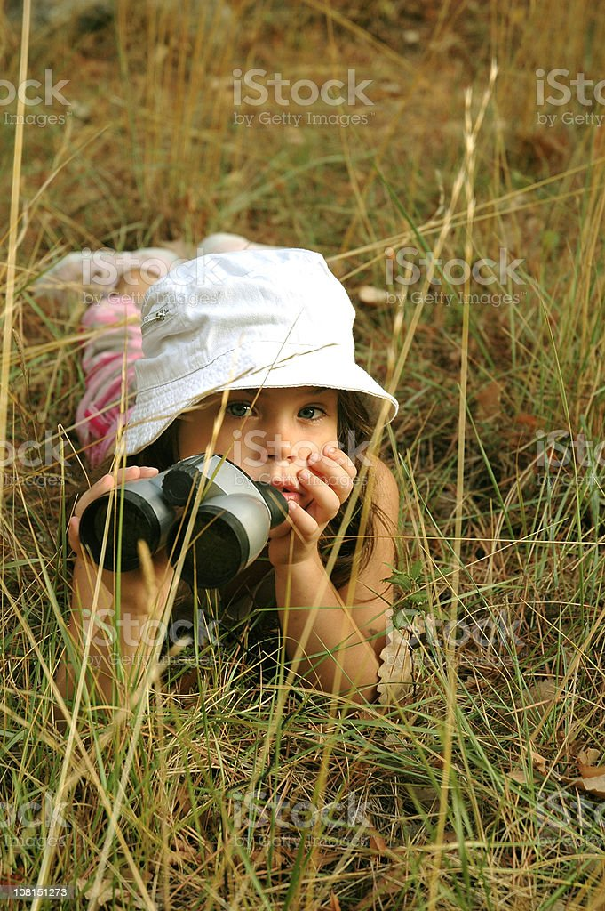 Girl with binoculars royalty-free stock photo