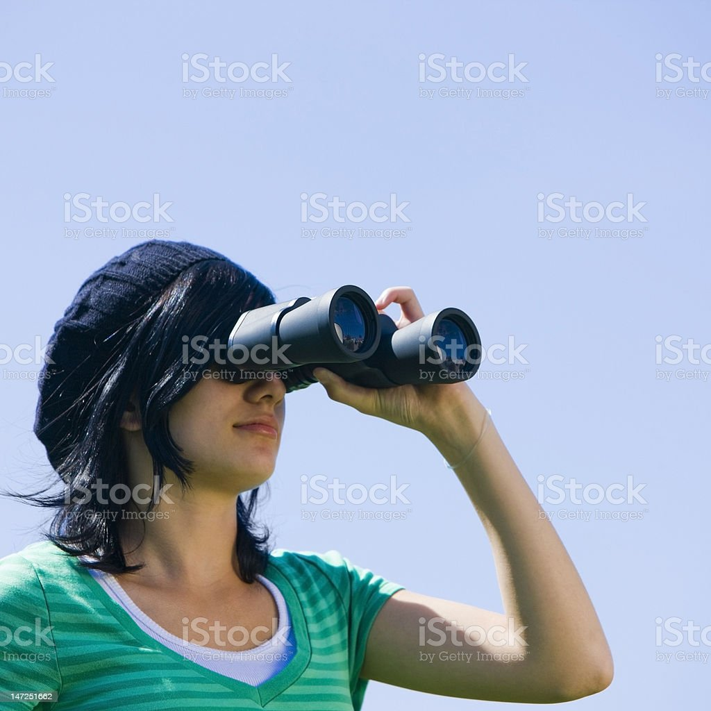 Girl with binoculars royalty-free stock photo