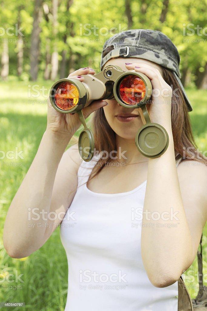 Girl with binoculars stock photo