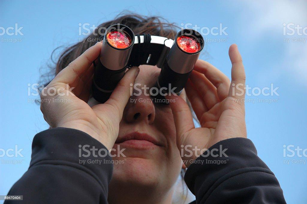 Girl with binoculars spy royalty-free stock photo