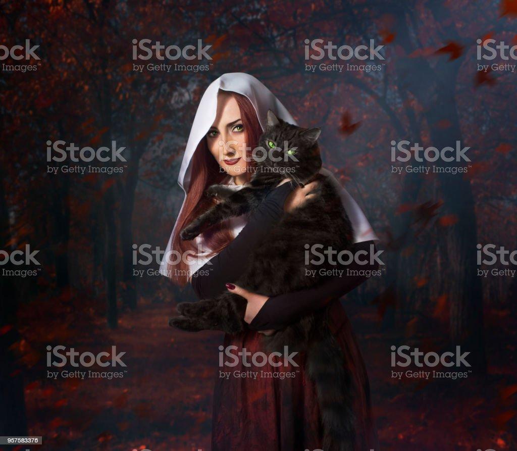 Chica con gato negro - foto de stock