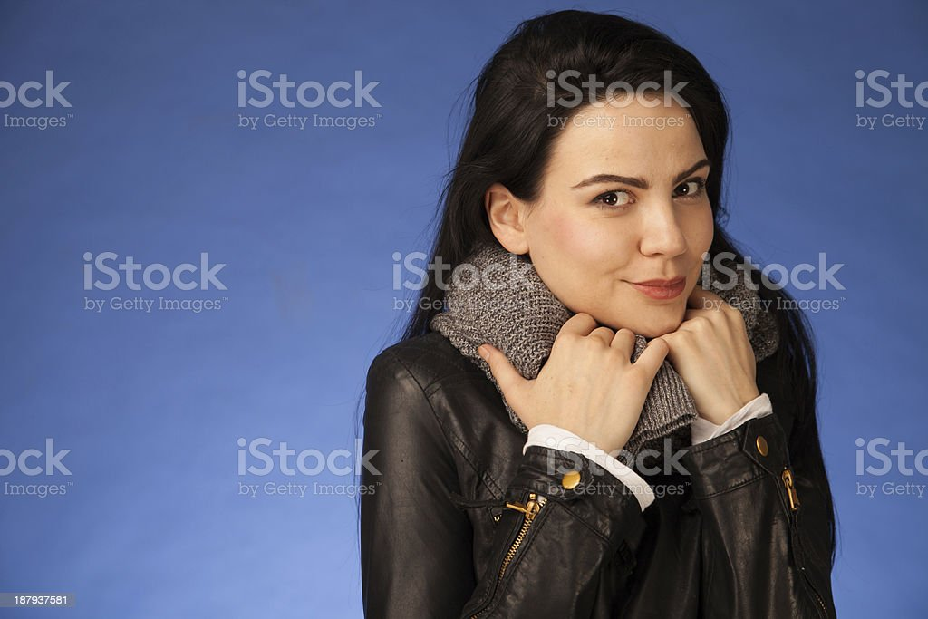 girl with black hair wearing a leather jacket and scarf stock photo