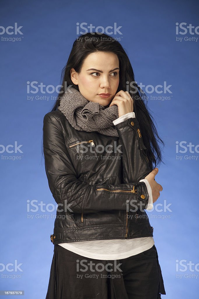 girl with black hair wearing leather jacket and scarf stock photo