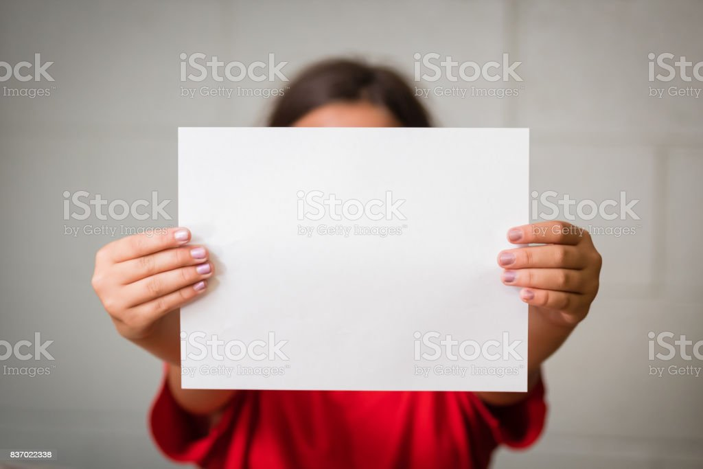 Girl with Blank Paper stock photo