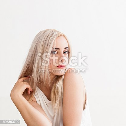 istock girl with blond dyed hair 506393720