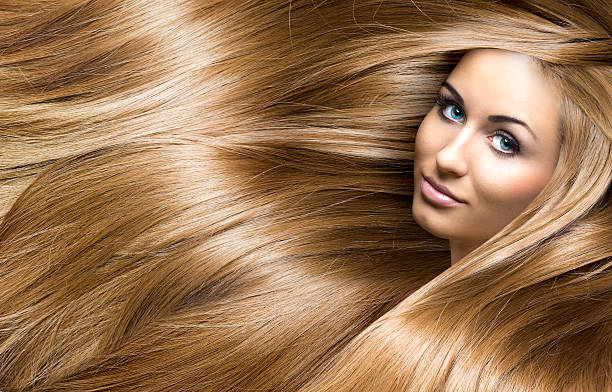 girl with blonde shining hair stock photo