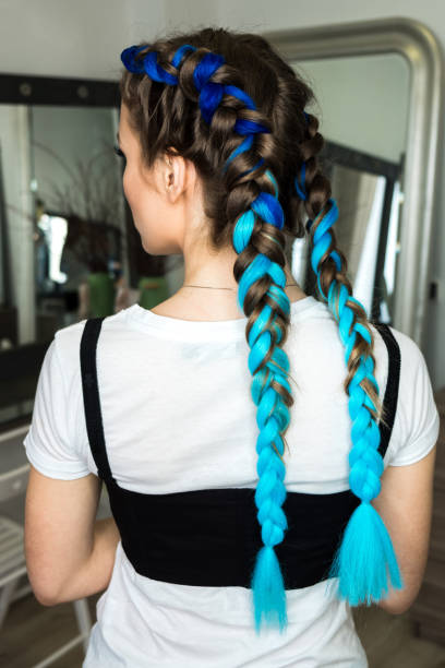 Girl with blue braids stock photo