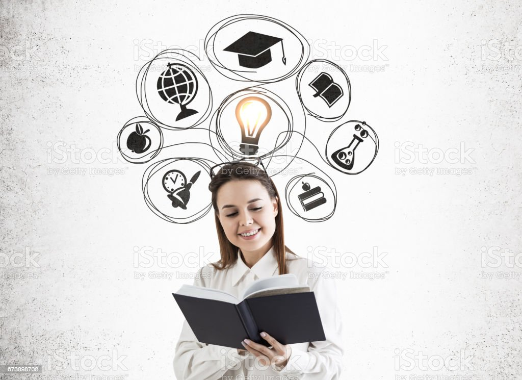 Girl with book and education choice, concrete foto de stock royalty-free