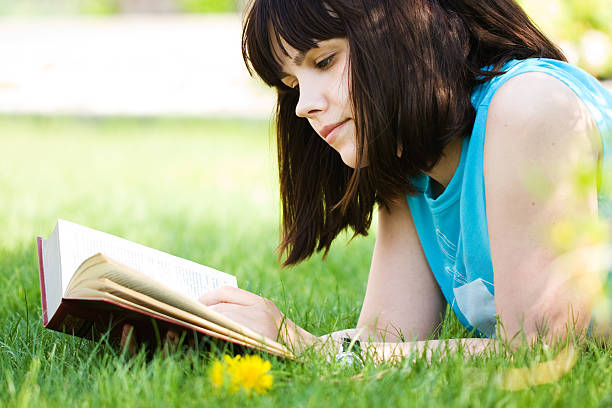 Girl with book stock photo