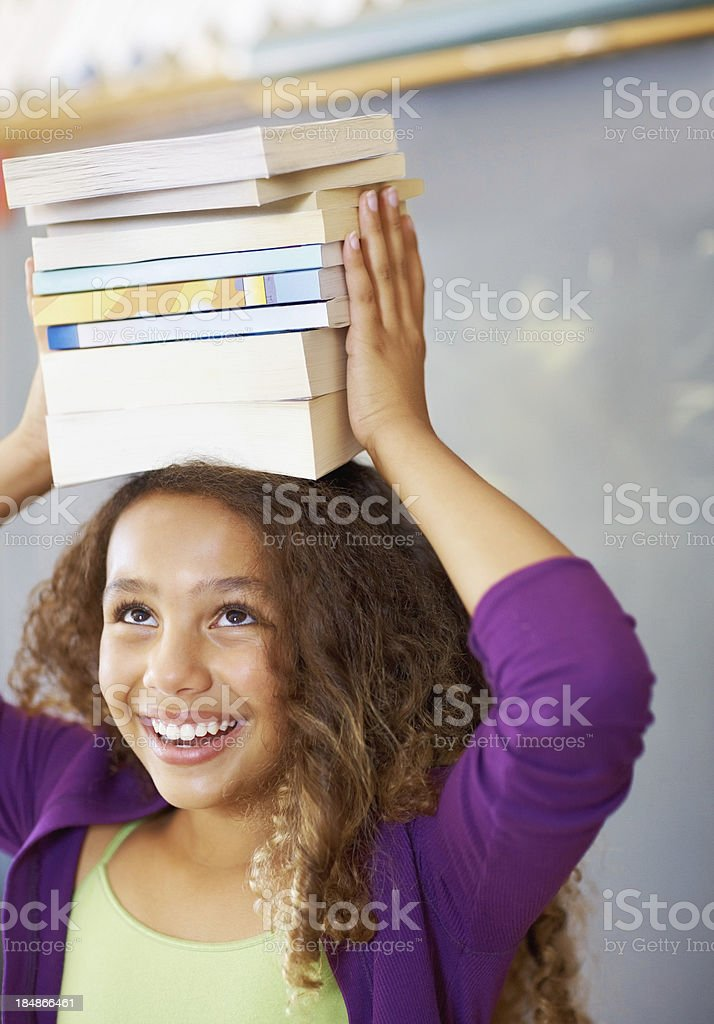 Girl with books on head royalty-free stock photo