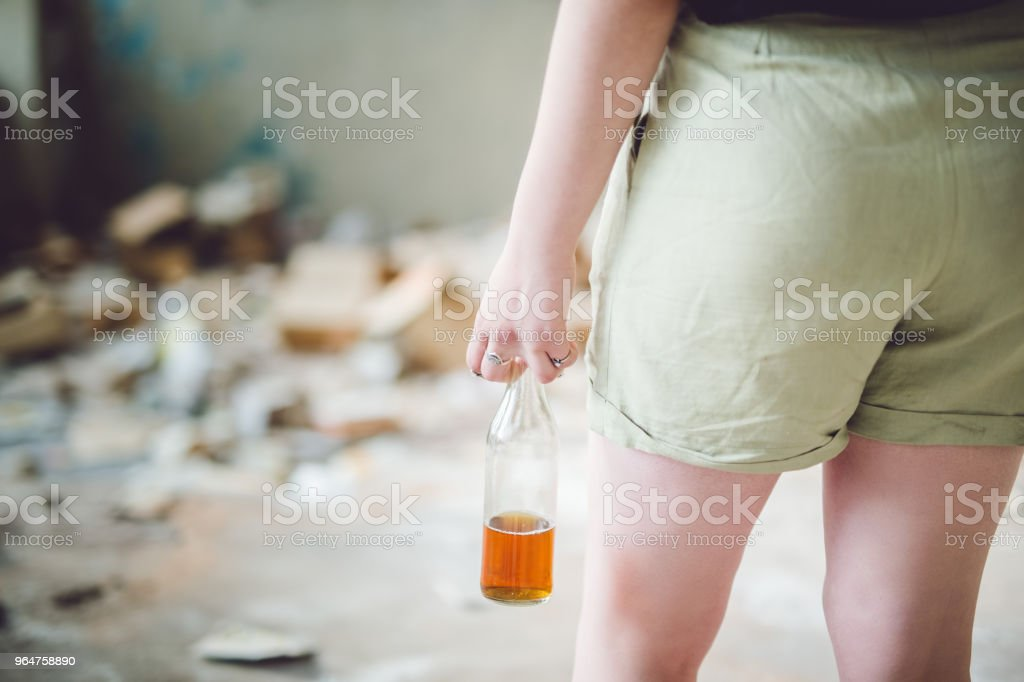 Girl with bottle royalty-free stock photo