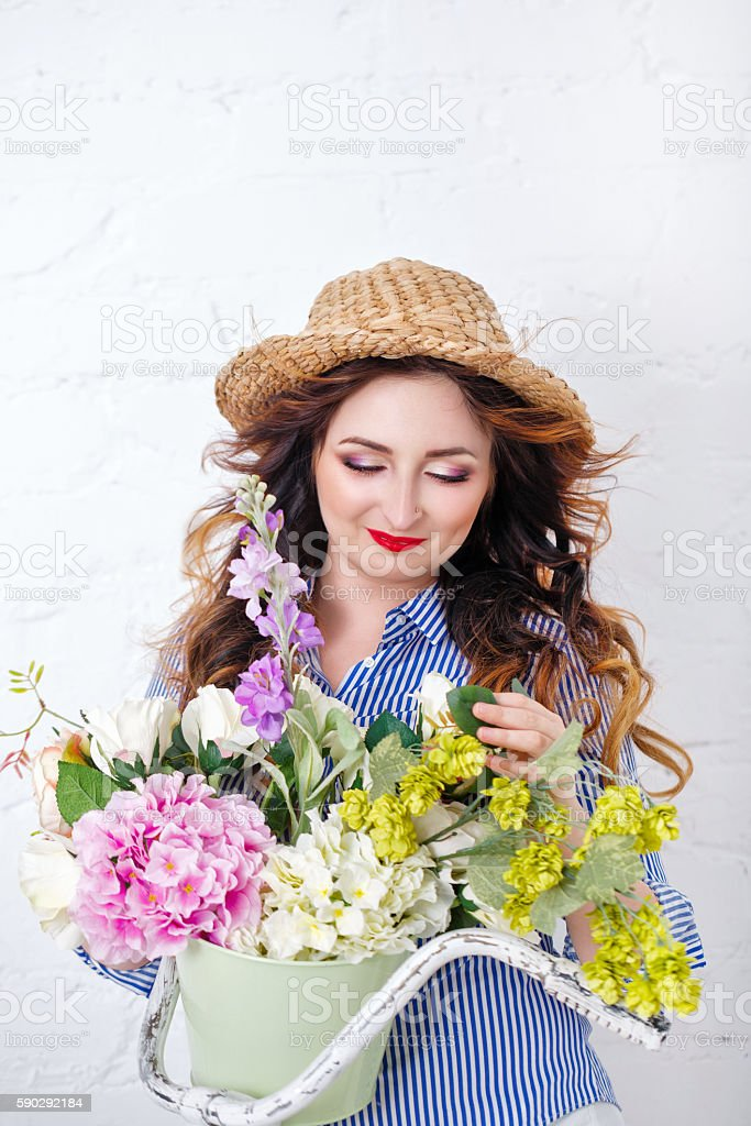 Girl with bouquet of flowers royaltyfri bildbanksbilder