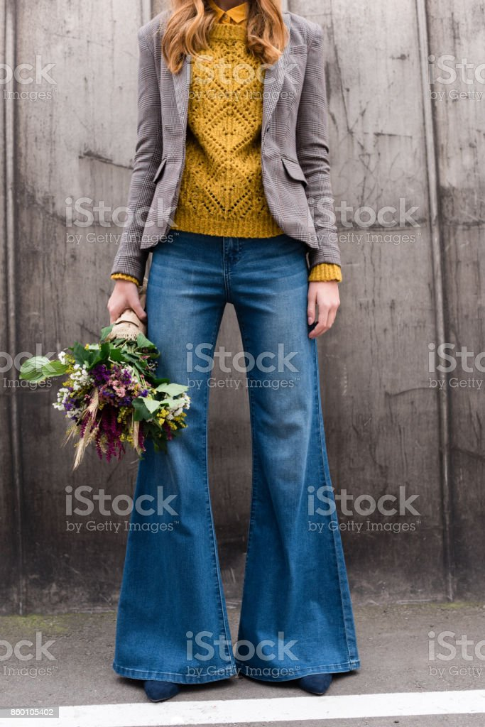girl with bouquet of flowers stock photo