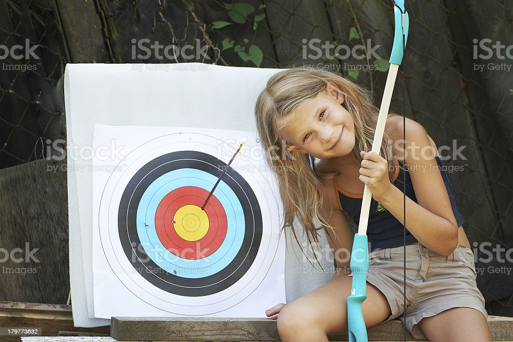 Girl with bow and sports aim stock photo