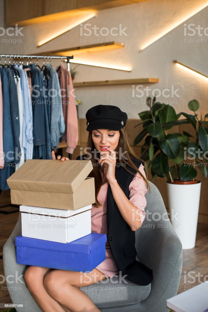 girl with boxes in boutique royalty-free stock photo