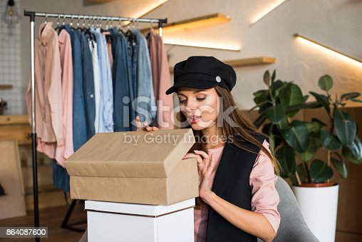 Girl With Boxes In Boutique Stock Photo & More Pictures of Adult