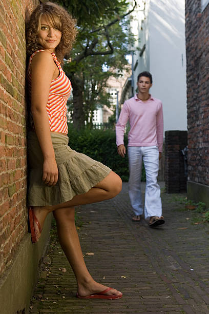 girl with boy approaching - animal hair stock photos and pictures