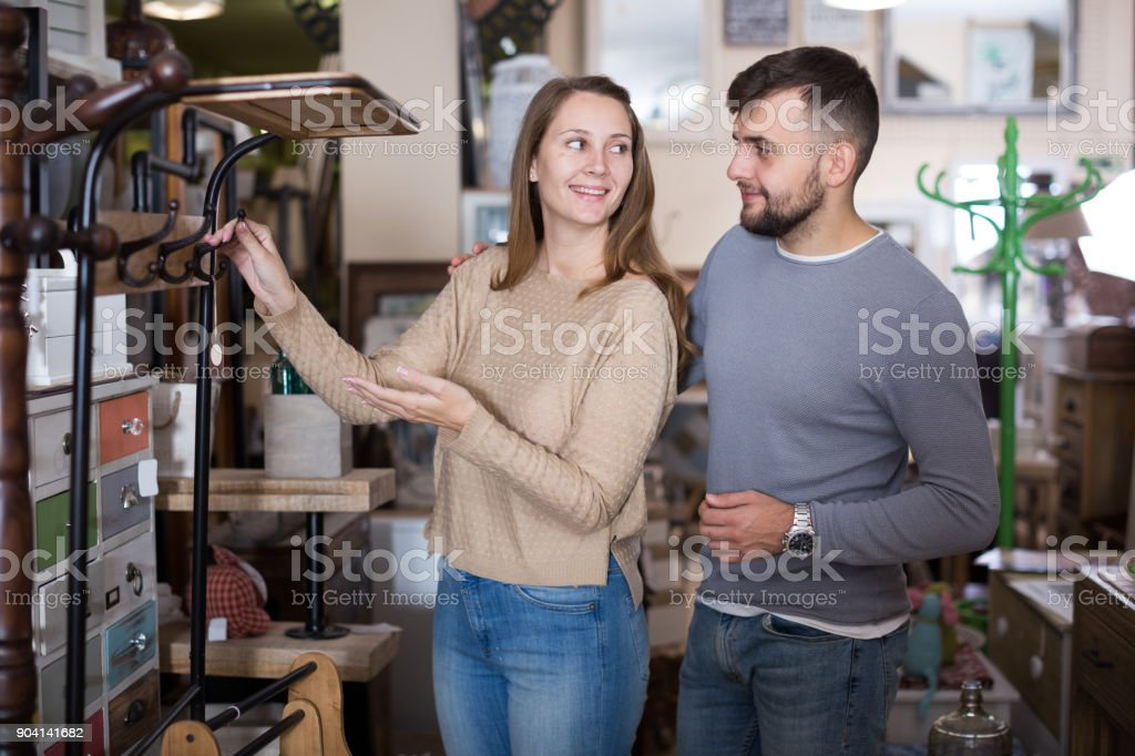 Girl with boyfriend buying hallstand stock photo