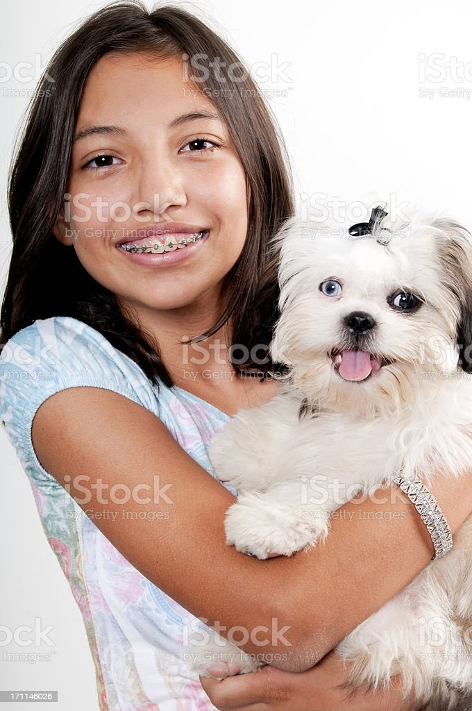 Girl with Braces and her dog royalty-free stock photo