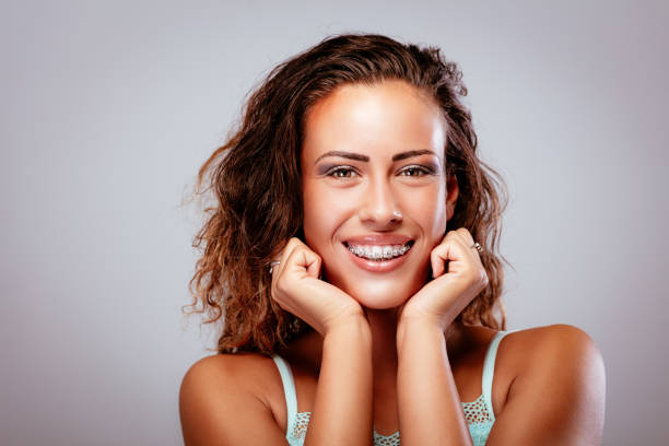 girl with braces - brace stock pictures, royalty-free photos & images