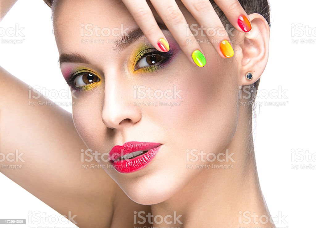 Girl With Bright Colored Makeup And Nail Polish Stock Photo & More ...