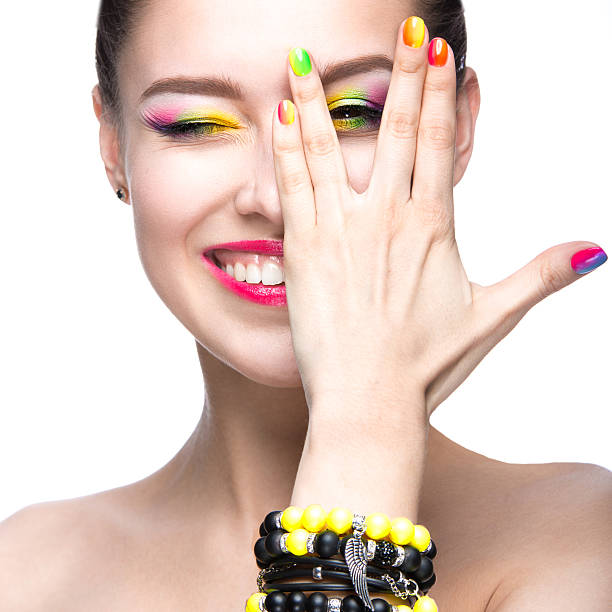 Girl with bright colored makeup and nail polish stock photo