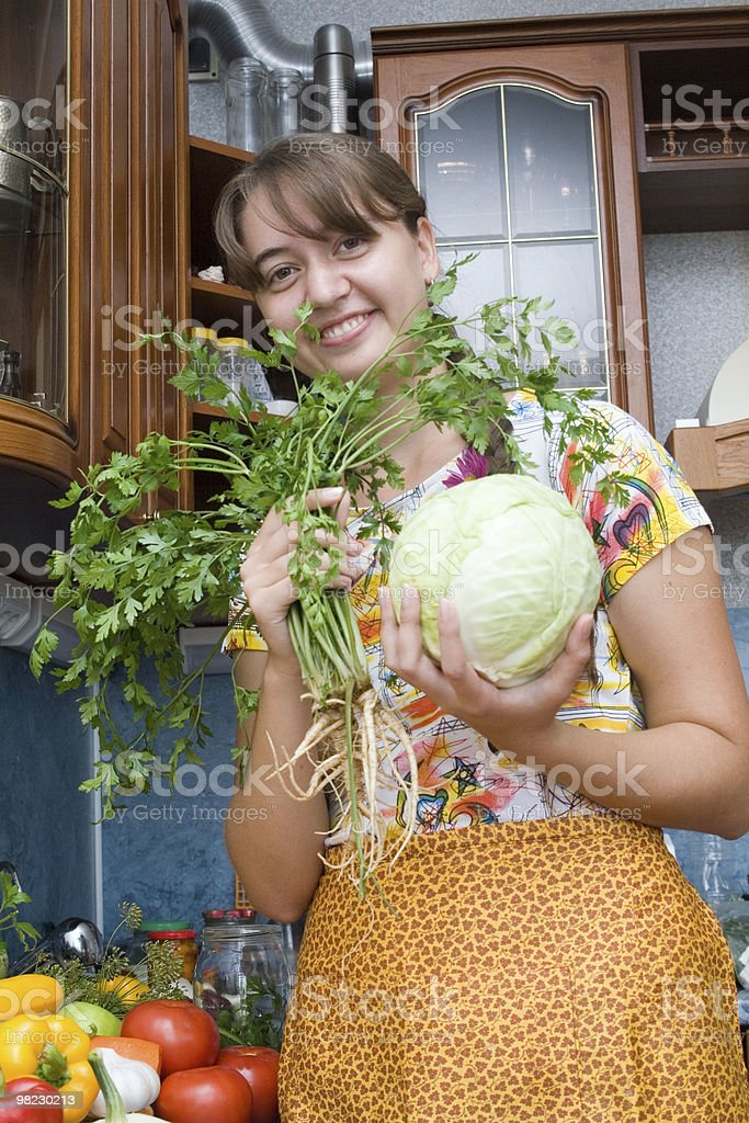 Girl with Cabbage and parsley royalty-free stock photo