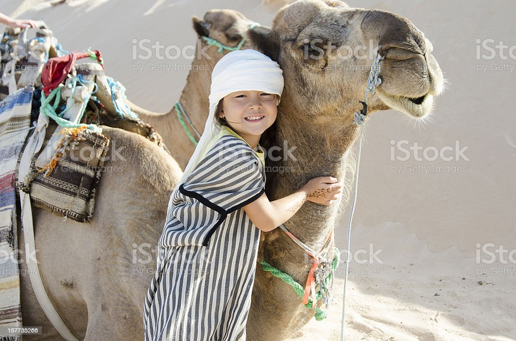 Girl with camel stock photo