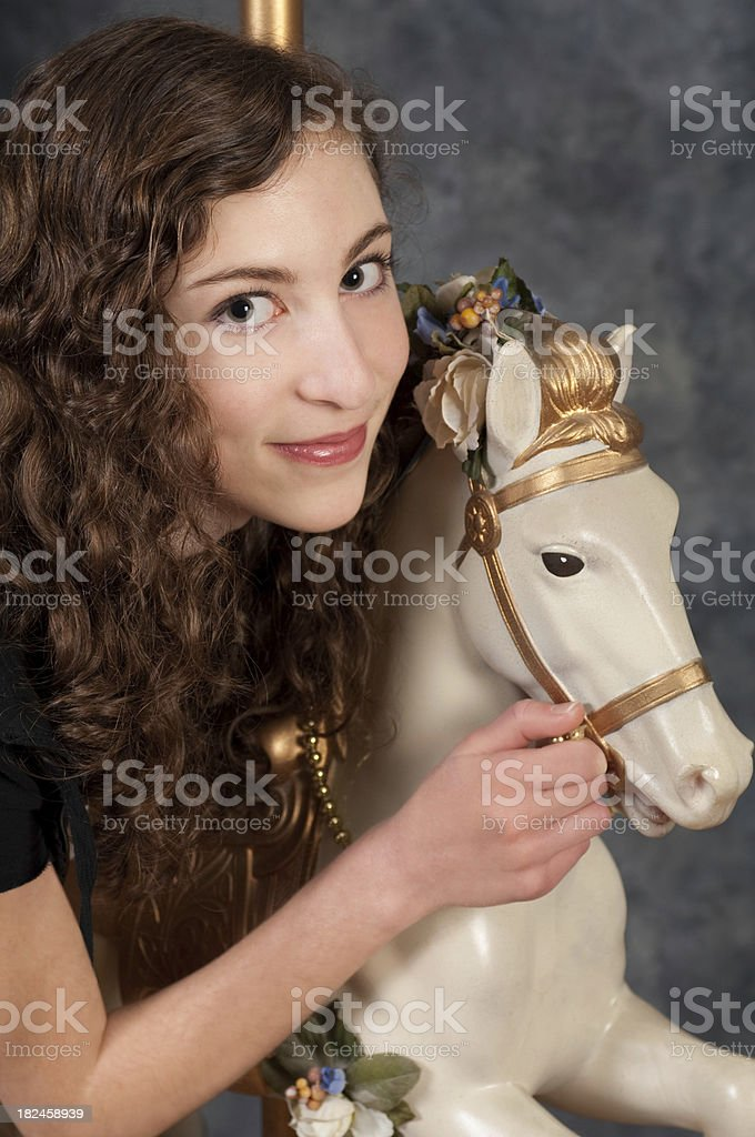 Girl With Carousel Horse royalty-free stock photo