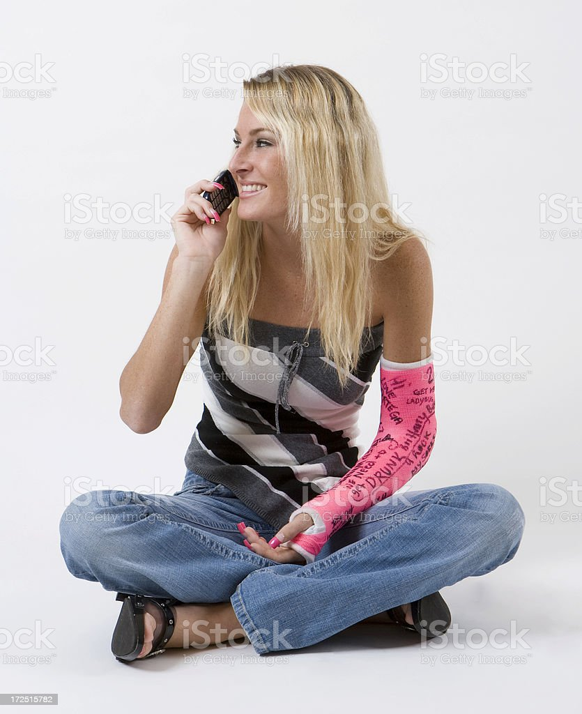 Girl with cast on cellphone royalty-free stock photo