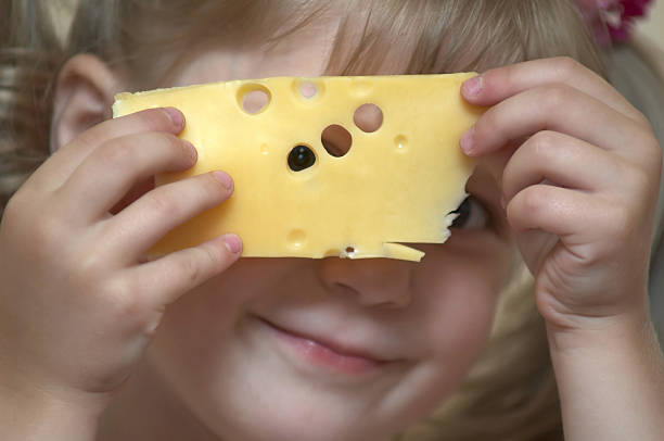 Girl with cheese stock photo