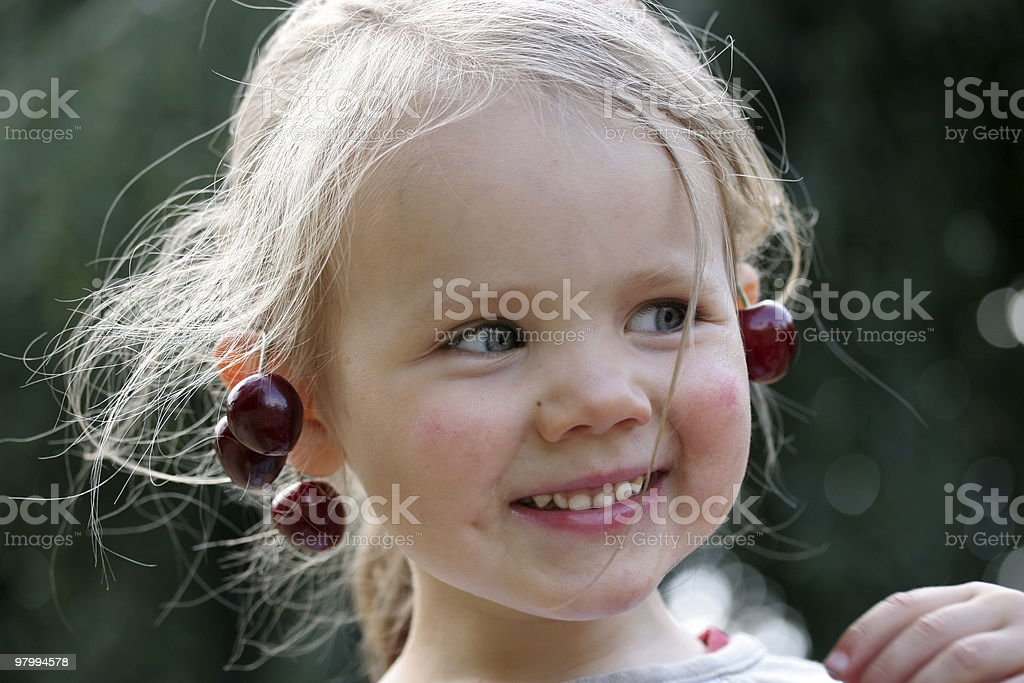 Girl with cherries royalty-free stock photo