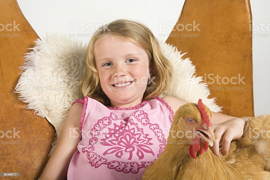 Girl with chicken 免版稅 stock photo