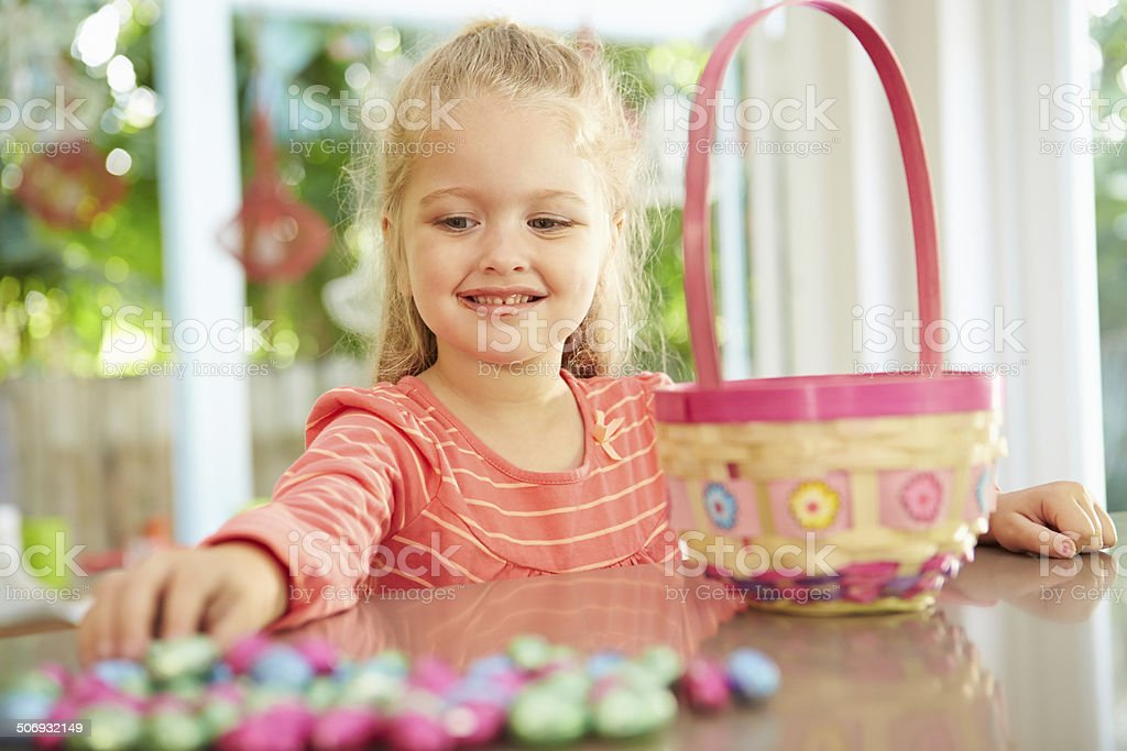 Girl With Chocolate Easter Eggs And Basket At Home royalty-free stock photo