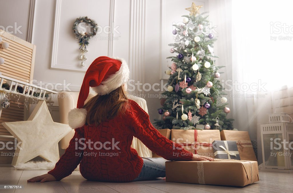 Merry Christmas and Happy Holidays! Cheerful cute little child girl...