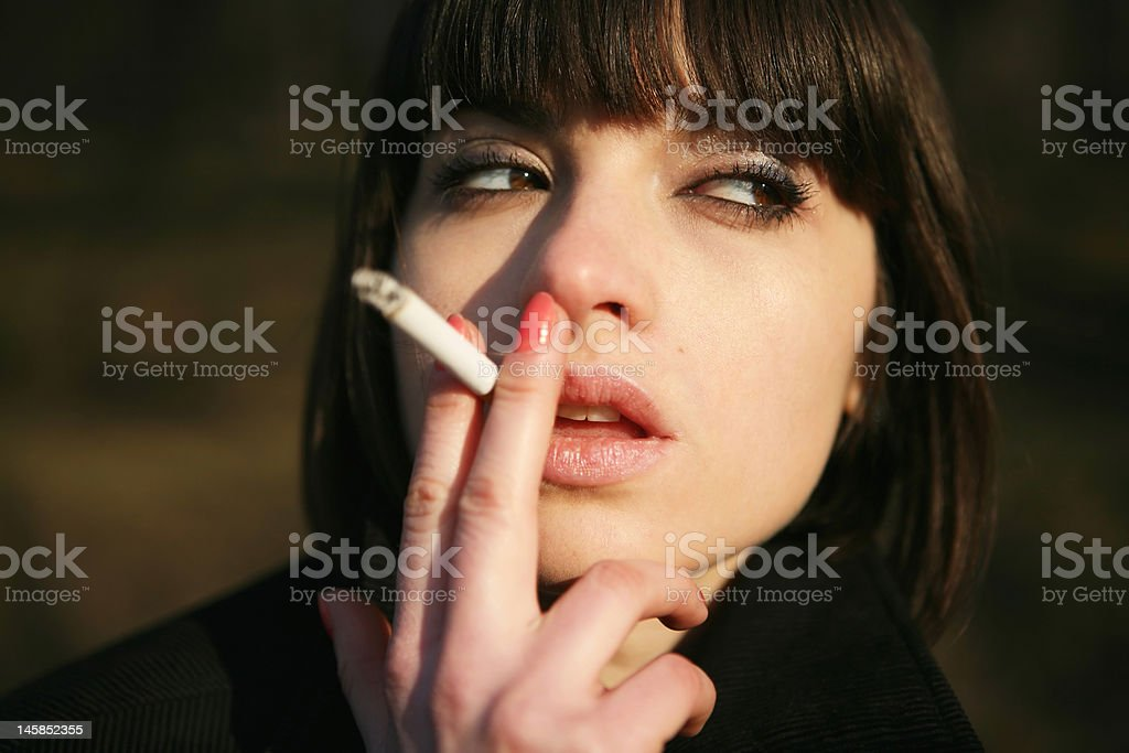 Girl with cigarette royalty-free stock photo