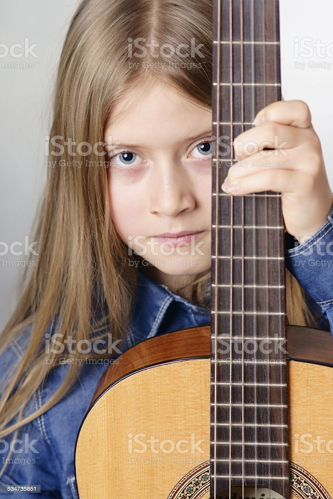 girl with classical guitar stock photo