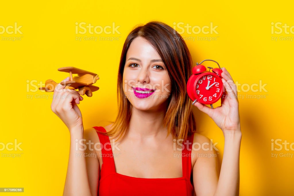 Girl with clock and airplane toy stock photo