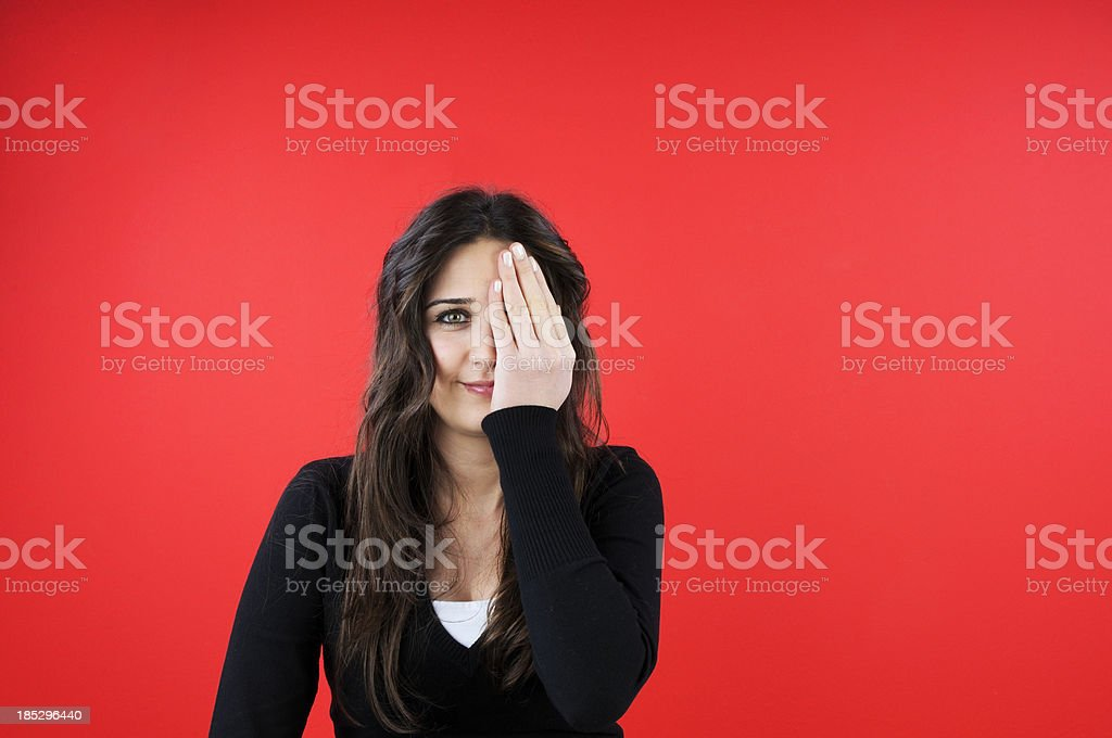 Girl with closed eye by hand. royalty-free stock photo