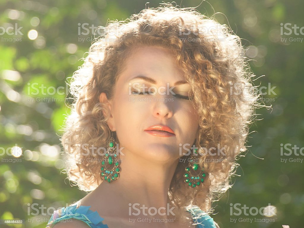 Girl with closed eyes in a summer day stock photo