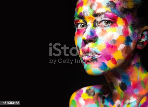 istock Girl with colored face painted. Art beauty image 484090466