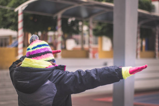 Girl with colorful winter hat stock photo