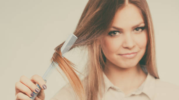 Girl with comb. stock photo